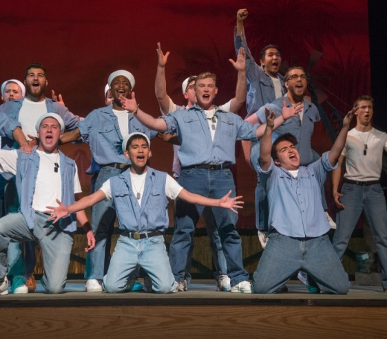 Jerod Giammanco as Luther Billis (center) and members of the company in the Lamont Opera Theatre production of Rodgers & Hammerstein's SOUTH PACIFIC